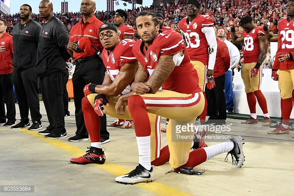 While you're focused on who's kneeling, the Nazis are killing